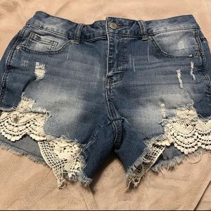 faded denim shorts with white lace and faux holes